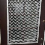 Help keep your property safe with this galvanised silver, diamond design window grille fitted to a property door in Kilwinning, Ayrshire.