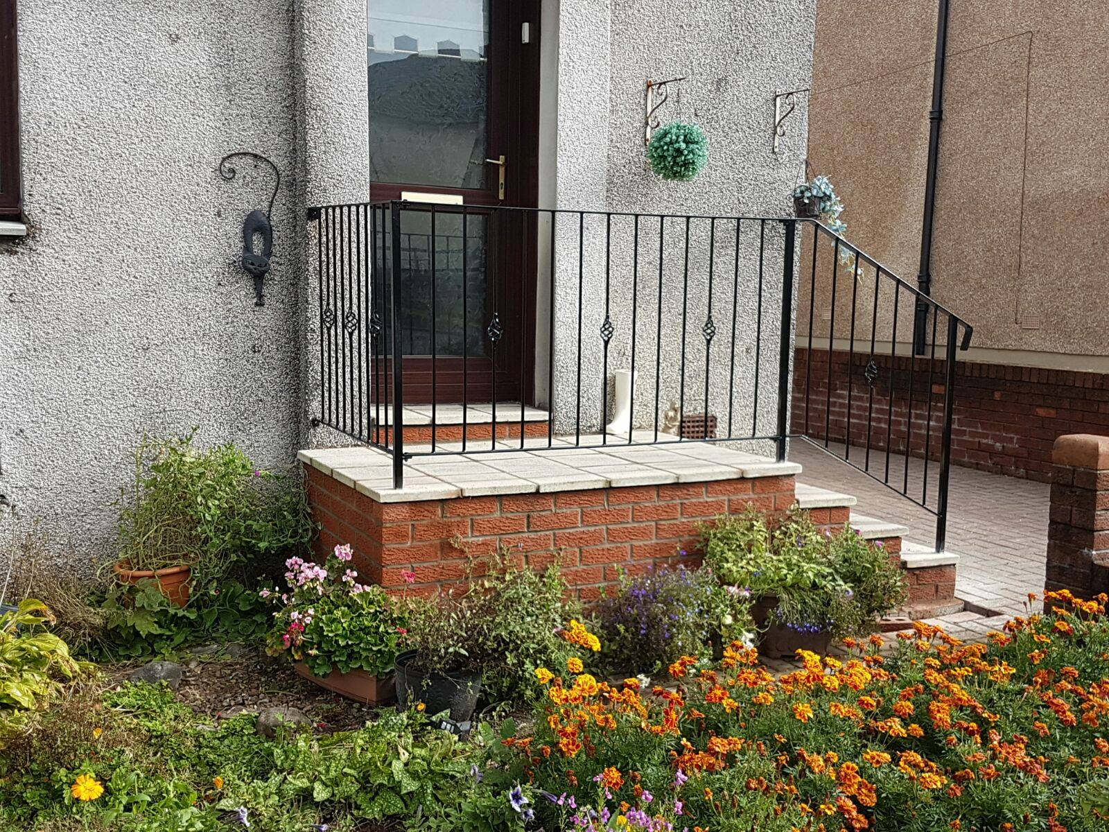 This simple but stylish black metal handrail ensures a safe entrance up the steps to this house, fitted in Saltcoats, Ayrshire.