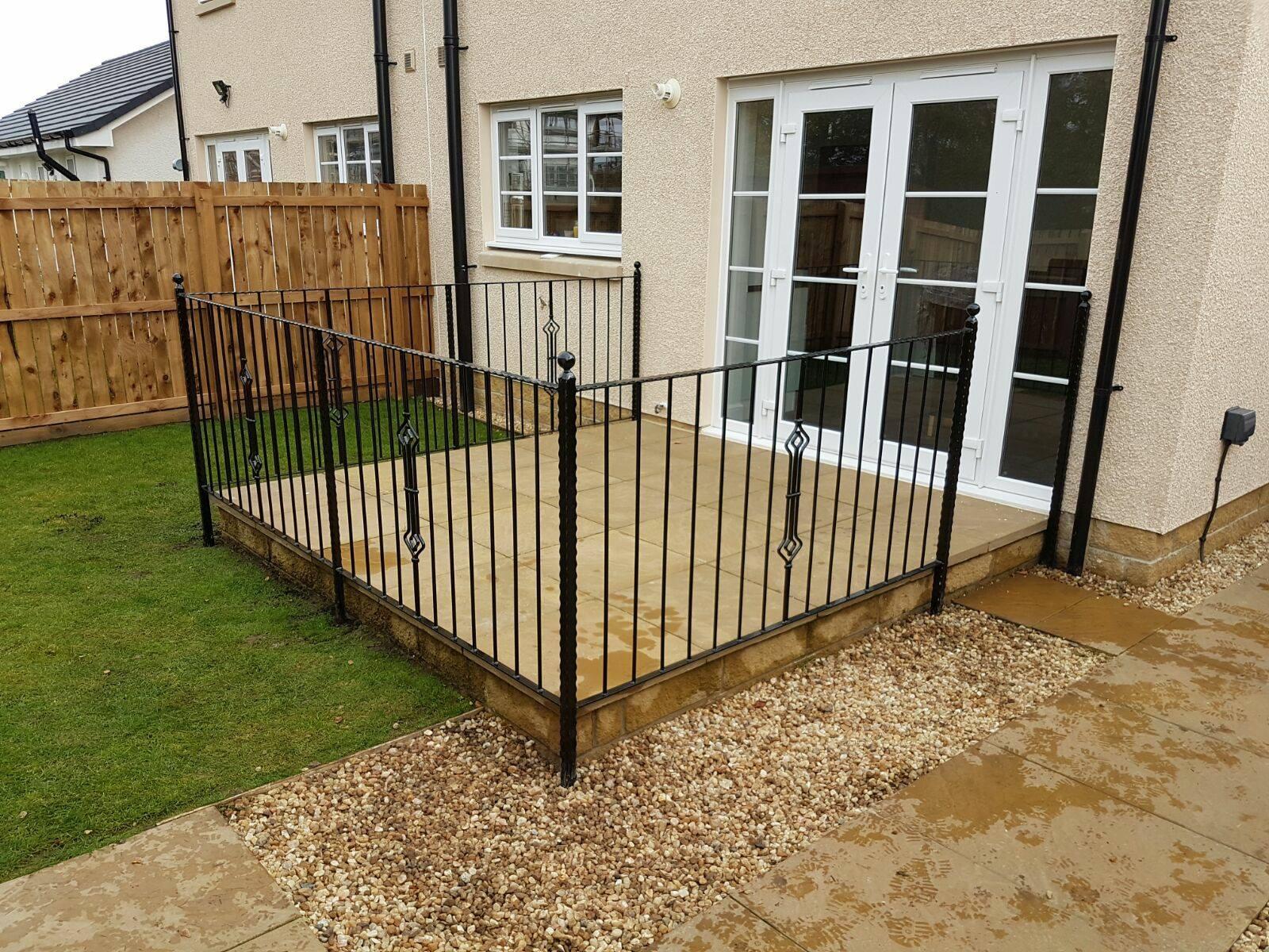 Stylish black metal railings to compliment customer's patio slabs in Barassie, Ayrshire. Custom built with diamond design, simple but elegant.