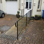 This black metal railing has a simple design which will never go out of fashion and ensures a safe entrance on the ramp to this property in Kilmarnock, Ayrshire.