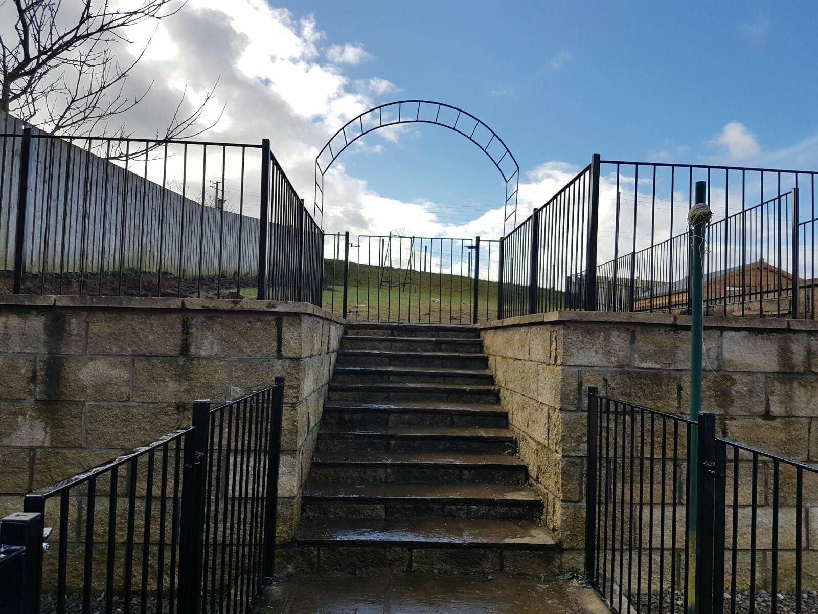 Metal fencing and archway fabricated by Dain Art Iron in Ayrshire