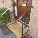 These classic brown metal handrails compliment the brown door and provide a safe entrance to this property in Dundonald, Ayrshire.