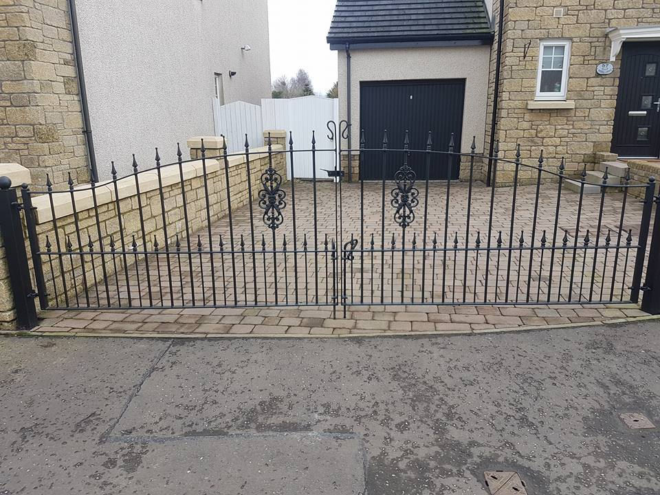 Professionally designed and fitted, these black metal driveway gates with spearheads are an excellent addition to this driveway. Fitted in West Kilbride, Ayrshire.