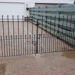 Metal driveway gates with ball top railheads by Dain Art Iron in Irvine