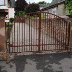 Arched heavy duty driveway gates by Dain Art Iron