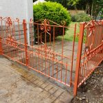 Decorative metal gates with matching fence panel by Dain Art Iron