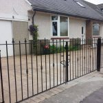 Simple but stylish black wrought iron driveway gates with spearhead and bush design. Fitted in Stewarton, Ayrshire.