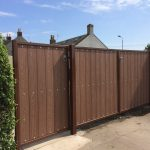 Pedestrian and double gates with galvanised and painted frames and brown composite wood boards fitted by Dain Art Iron.
