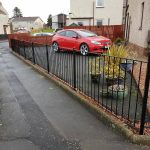 Simple metal fence with decorative baskets installed in Kilmarnock by Dain Art Iron