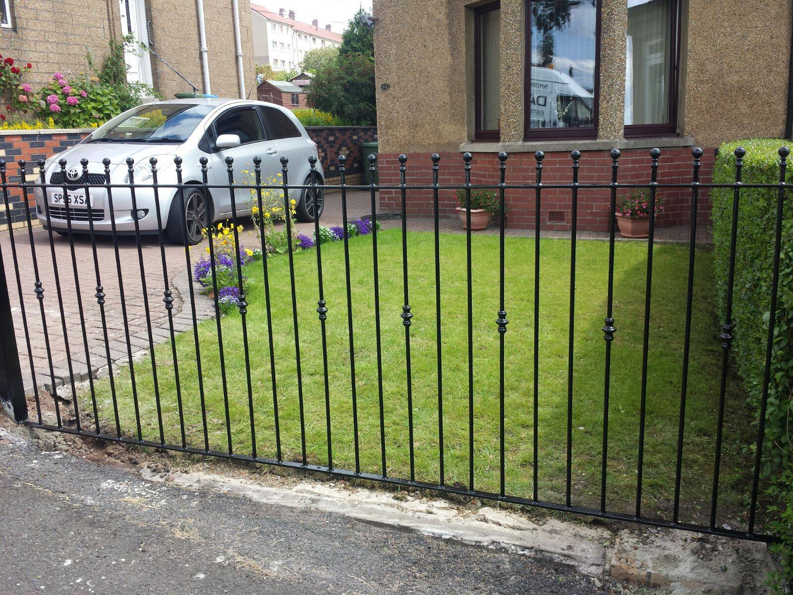 Metal fence with ball rail heads and bushes in Kilmarnock by Dain Art Iron