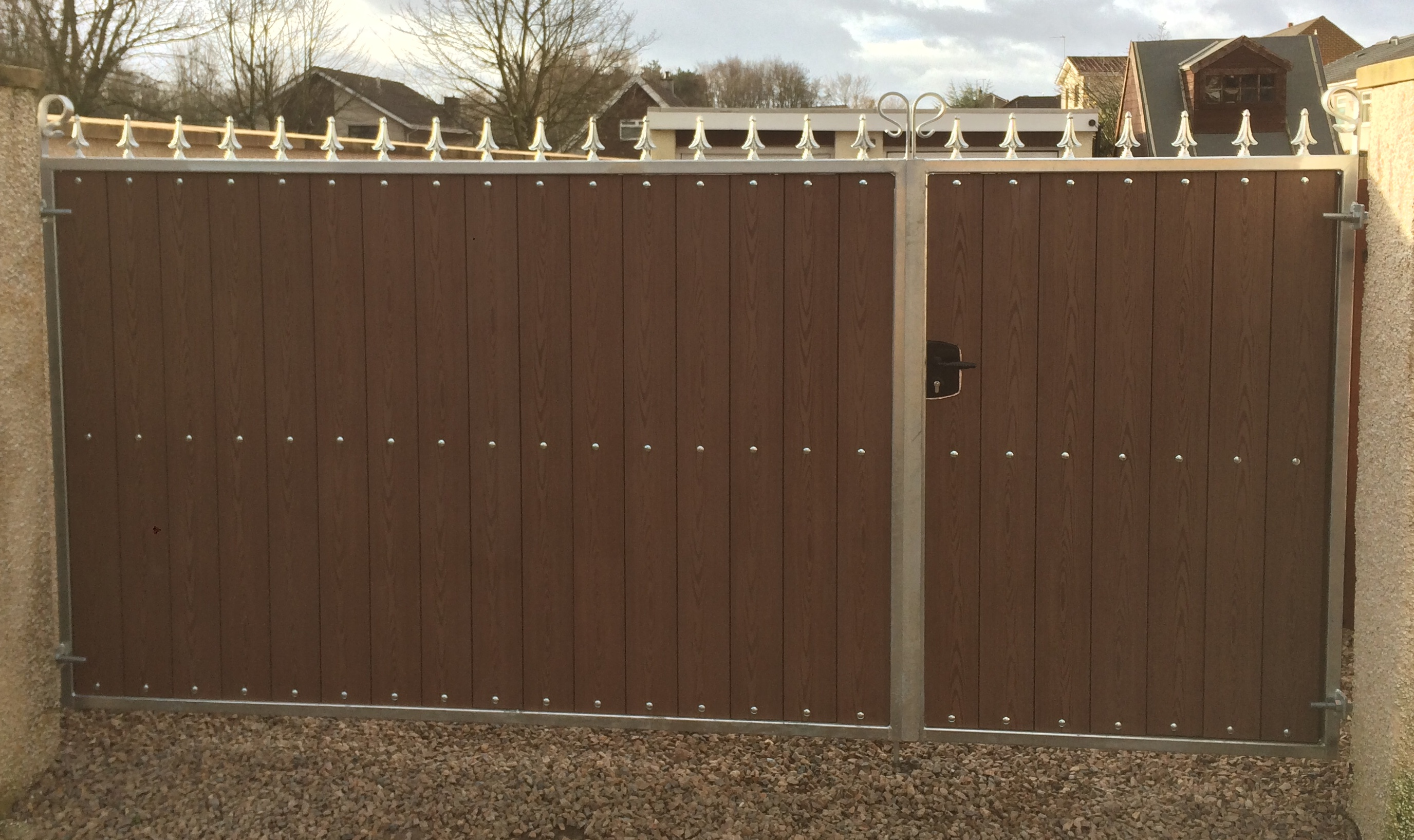 Galvanized frame driveway gates with composite boards and railheads