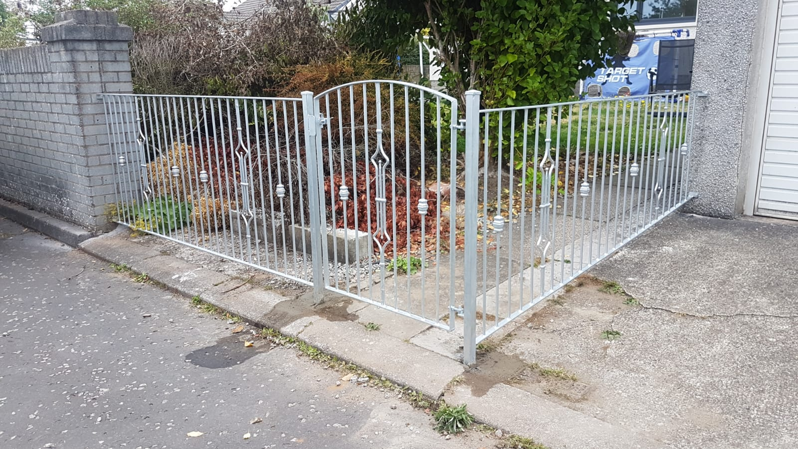 Modern galvanized metal fence railing fabricated and installed by Dain Art Iron of Irvine, Scotland