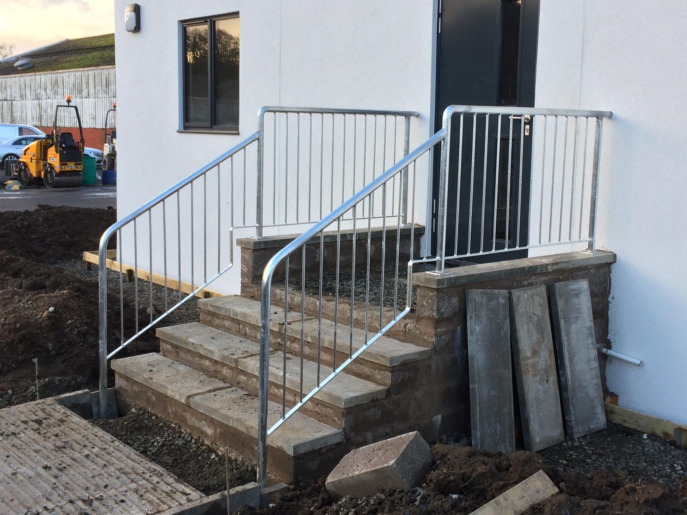 Commercial tubular metal access handrail by Dain Art Iron