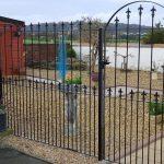 Metal fence and garden gate with fleur de lis railheads by Dain Art Iron, Ayrshire, Scotland