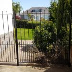 Tall metal fence and garden gate fabricated and installed in Alloway by Dain Art Iron of Ayrshire, Scotland