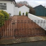 This intricate circle and scroll design metal gate and panel have been skilfully designed and crafted and finished with a black gloss in Irvine, Ayrshire.