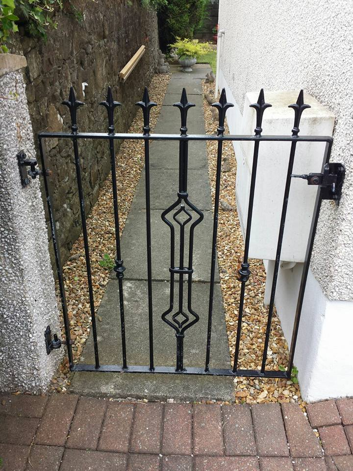 Made to measure black metal side gate with diamond centre design and spearheads. Designed, built and fitted by Dain Art Iron in Ayrshire.