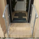 Simple silver bush design galvanised metal handrail fitted at the customer's front door steps in Kilmarnock, Ayrshire.
