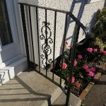 Metal handrail installed in Ayrshire with decorative panel and textured edge flatbar and box section.