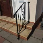 Handrail with decorative centre panel and textured edge metal frame, finished in black gloss.