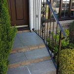 Metal handrail with decorative panel installed in Ayr by Dain Art Iron.