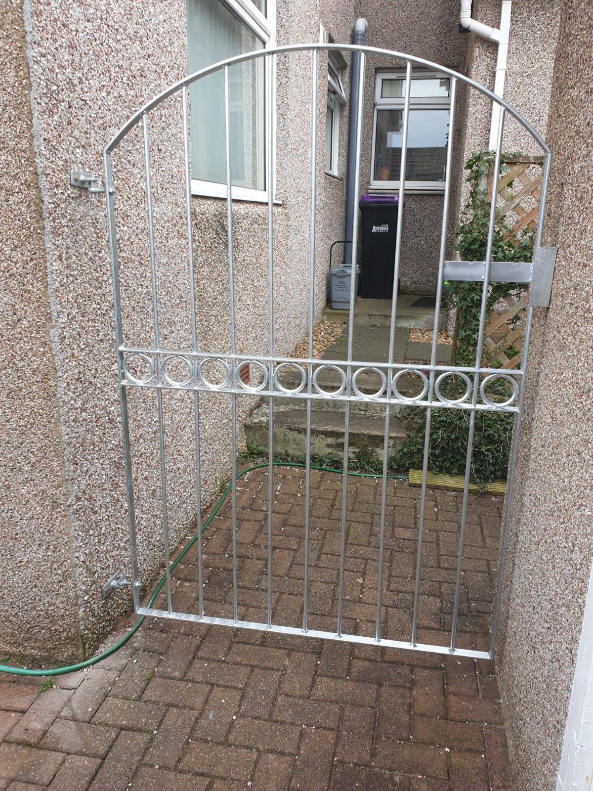 Galvanized metal gate by Dain Art Iron, Irvine