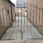 Decorative metal driveway gates, galvanized to prevent rust.