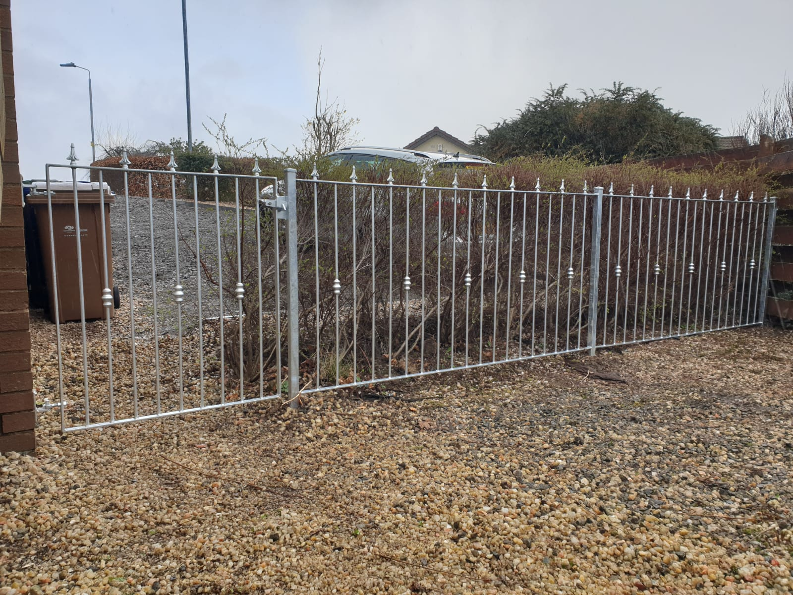 Galvanized metal fence and gate by Dain Art Iron of Ayrshire, Scotland.