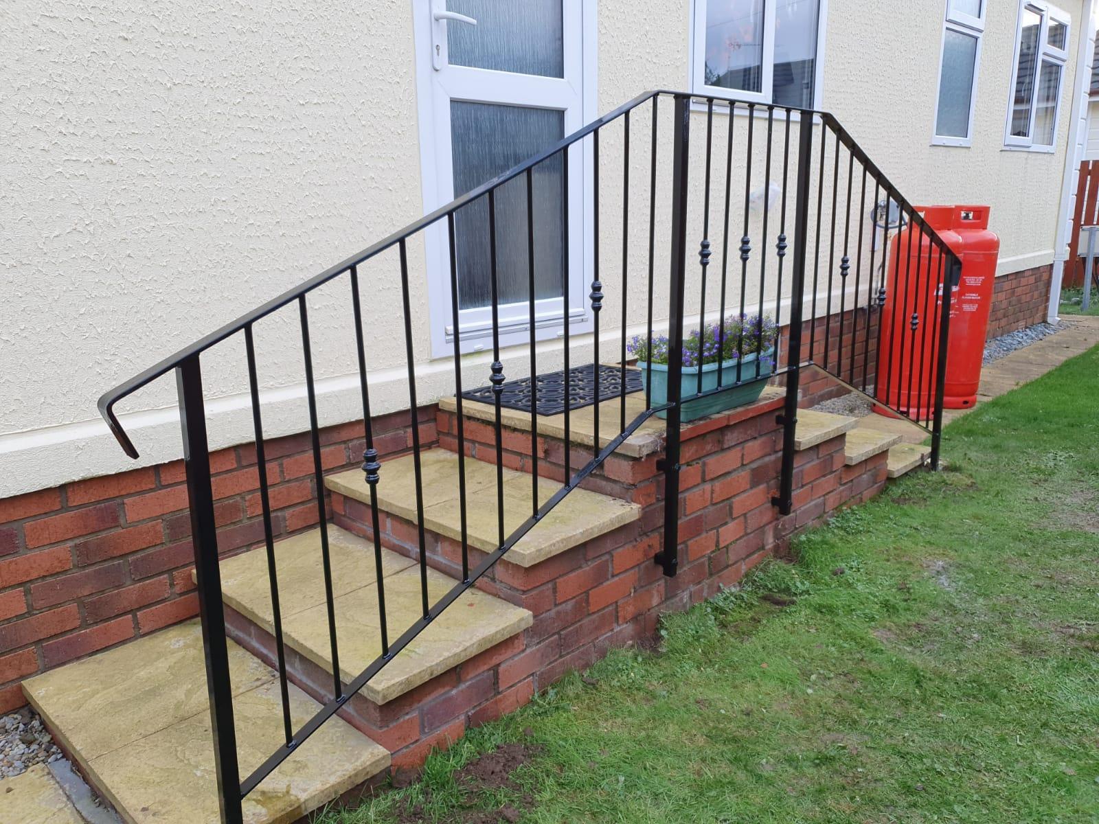 Custom handrail for platform by Dain Art Iron in Irvine