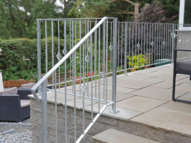 decorative galvanized handrail with baskets installed by Dain Art Iron in Ayrshire