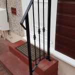 Handrail for door step finished in black gloss, fabricated and installed by Dain Art Iron