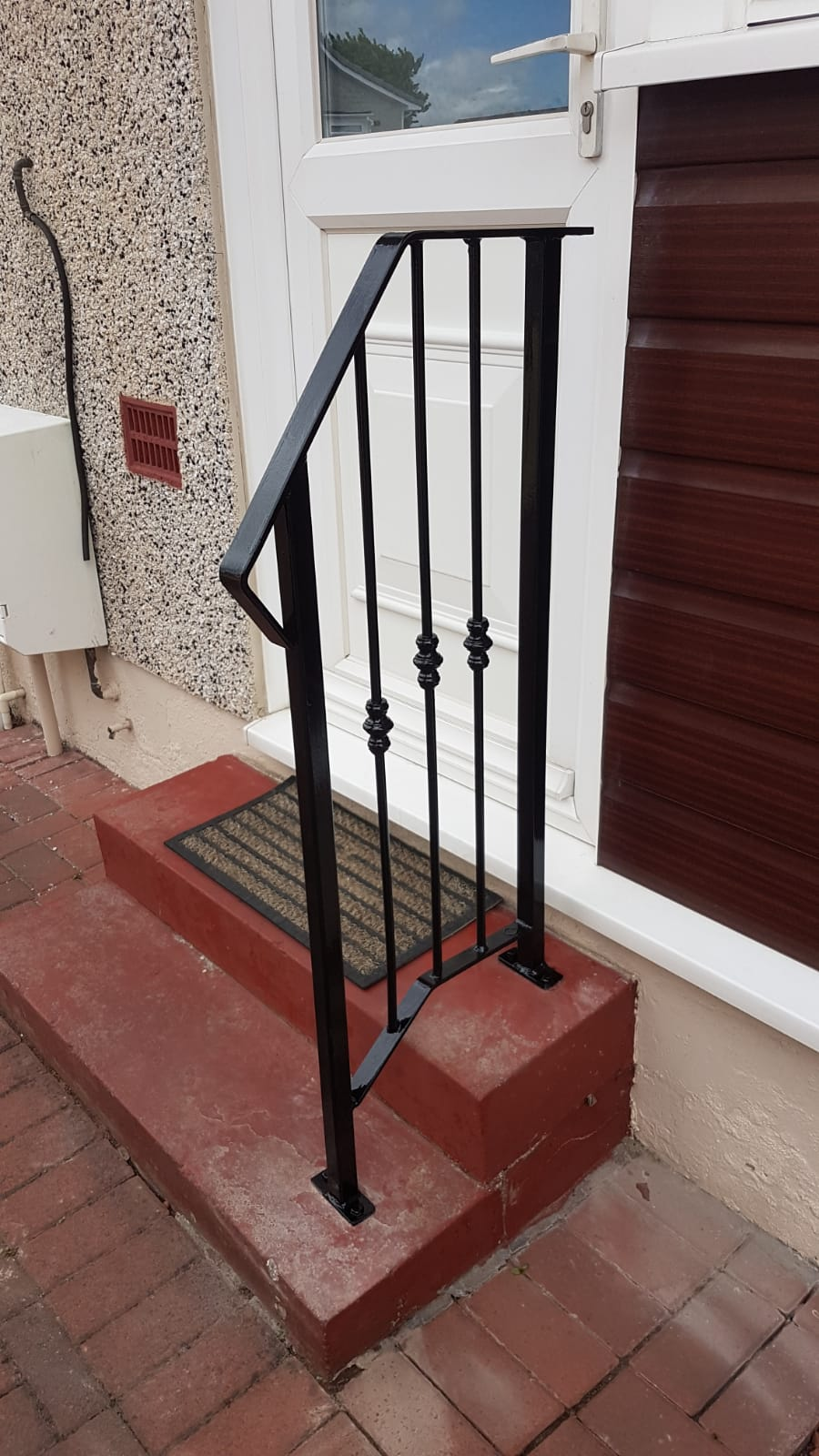 Decorative metal handrail installed in Ayrshire