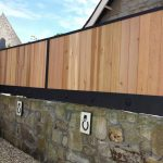 This stylish wooden fence finished with black metal surround and adornments really stands out at this property in Troon, Ayrshire.