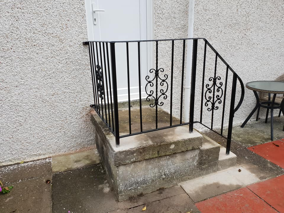 Decorative handrail for steps fabricated and installed by Dain Art Iron