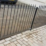 Elegant black metal railing with spearhead design creates a stylish boundary between properties in Ayrshire.
