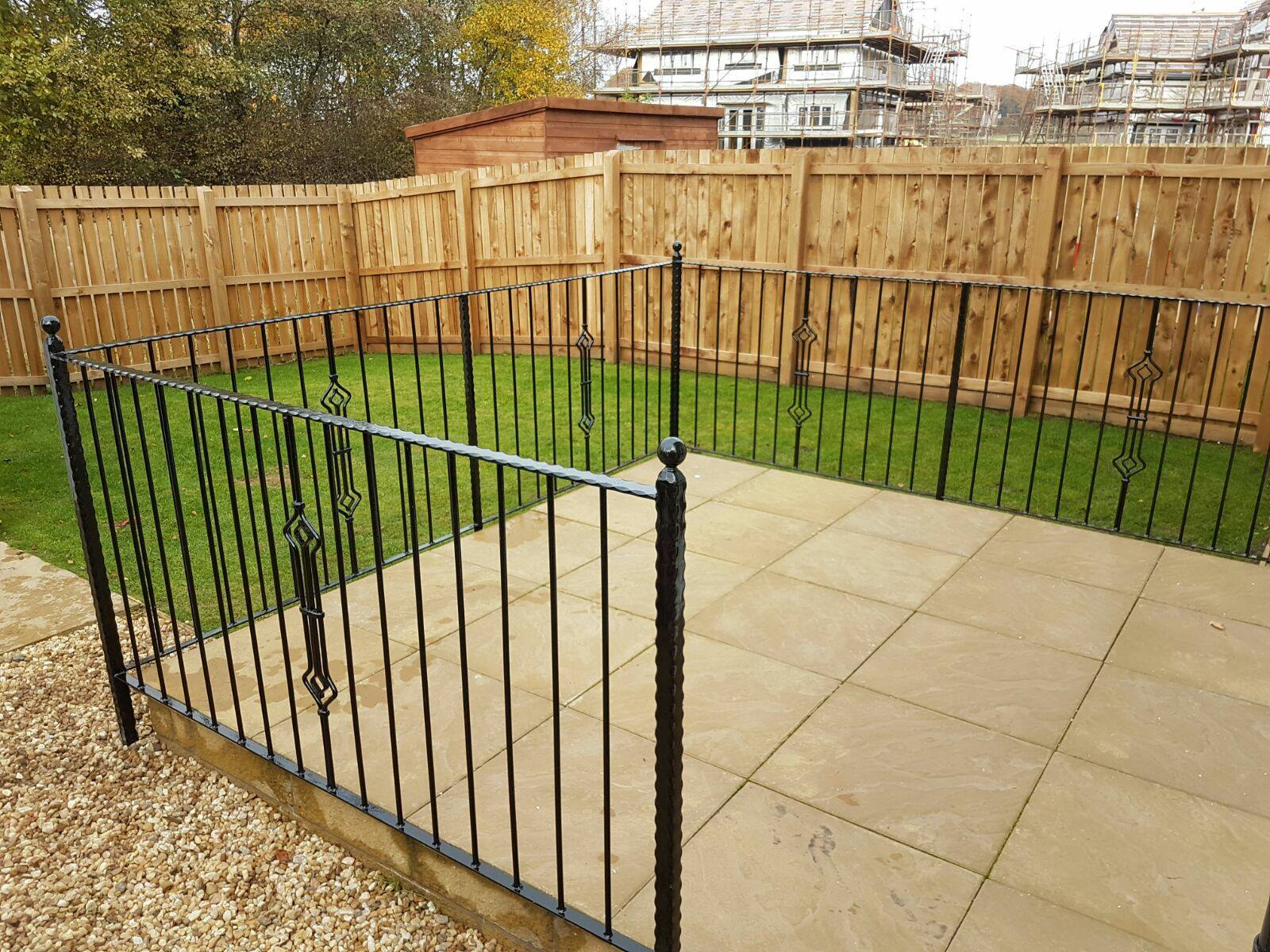 These beautiful black metal railings with diamond motif and twisted metal handrail design provide a stylish finish to their patio in their beautiful garden in Stewarton, Ayrshire.