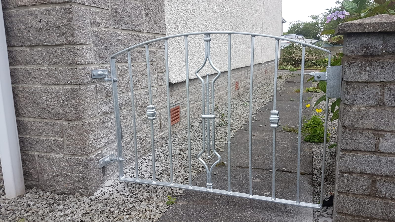 Arched galvanized garden gate by Dain Art Iron, Scotland
