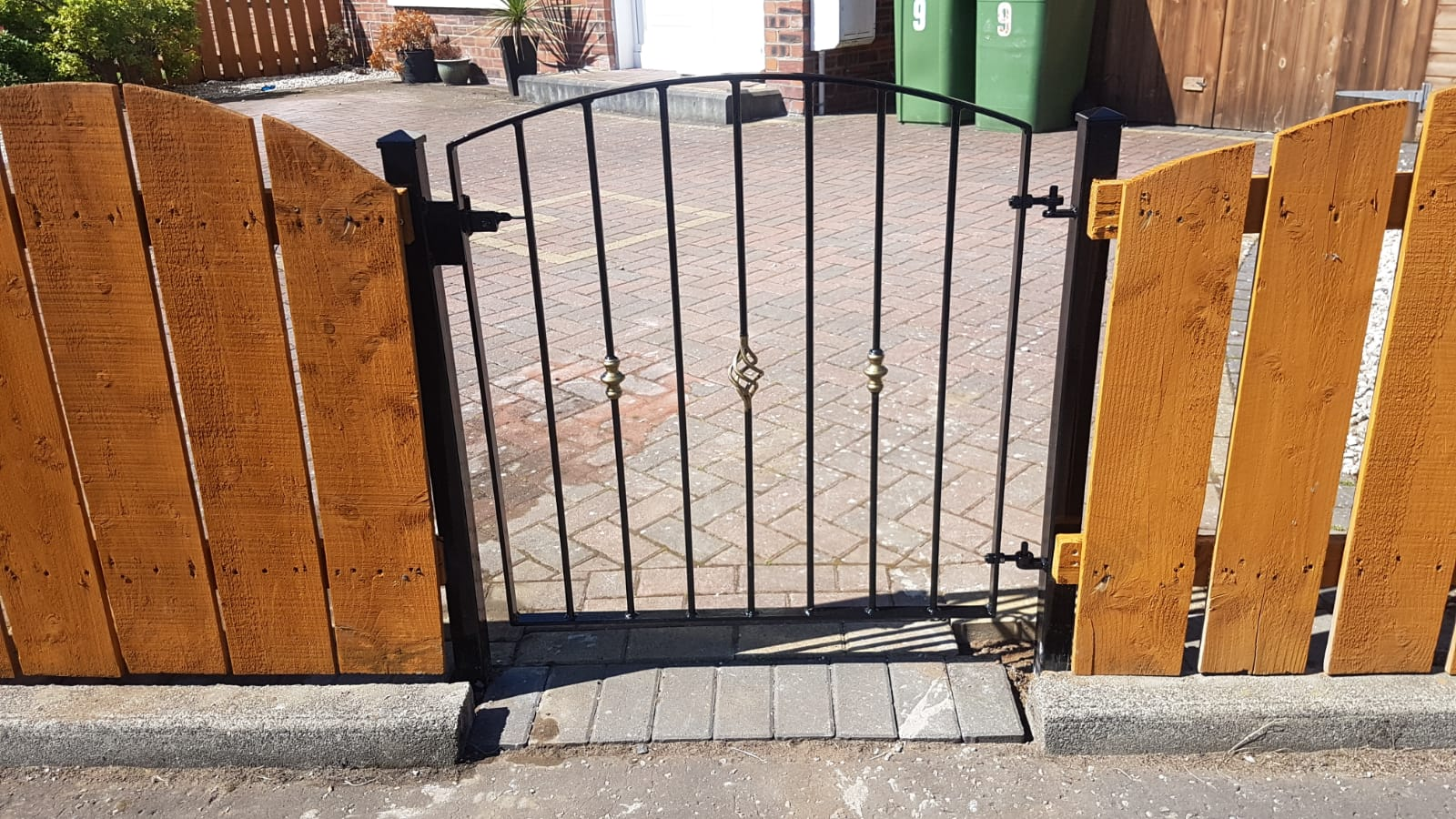Simple arched metal gate, Ayrshire, Scotland
