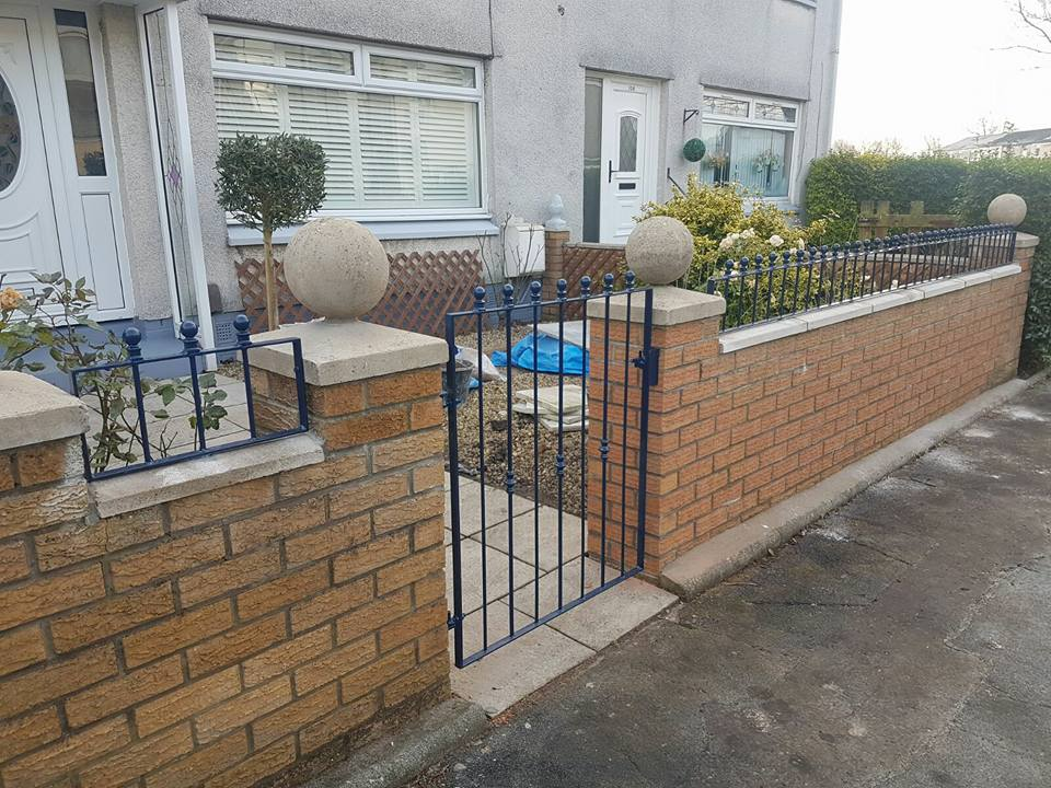 These low black wall railings with sphere finish really compliment the gate and prevent passers-by sitting on the customer's wall in Irvine, Ayrshire.