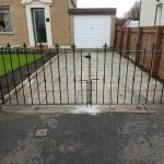 These double driveway gates with alternating spearhead design have been painted to give a smart looking finish in this street in Irvine, Ayrshire.