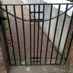 A black metal square single gate Rennie Mackintosh inspired, refurbished and refitted by Dain Art Iron in Ayrshire.