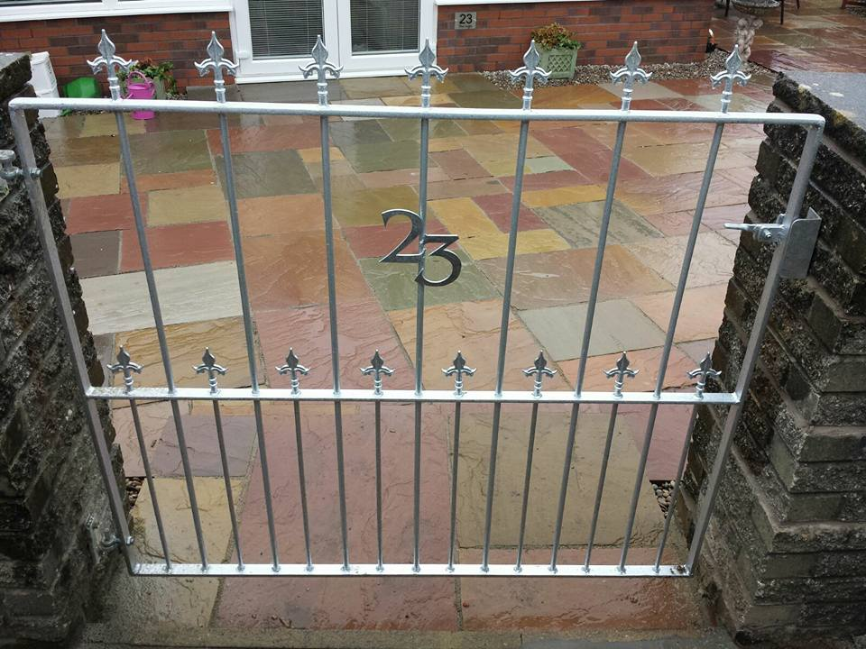 A gate designed to keep the dog in and compliment the customer's beautiful coloured paving. Galvanised and left unpainted so there was no future upkeep required. Fitted in Troon, Ayrshire.
