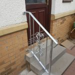 Galvanised handrail with scroll work panel and textured edge box section, fitted in North Ayrshire.