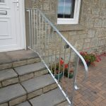 Maintenance free galvanised handrail with bow finish, supplied and fitted in Irvine, Ayrshire.