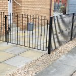 Metal fence and matching driveway gates