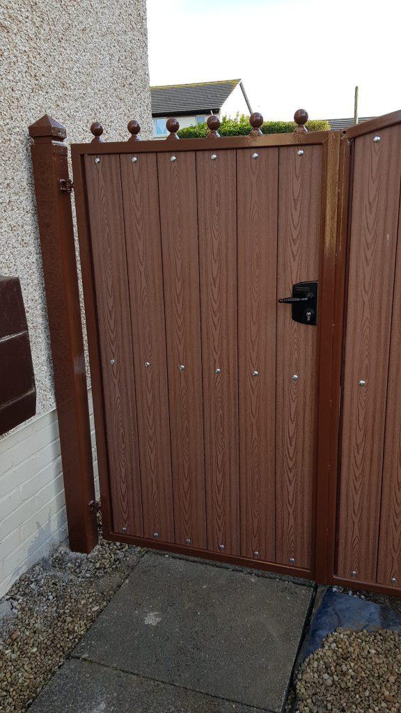 Composite garden gates with brown frame installed by Dain Art Iron in Irvine