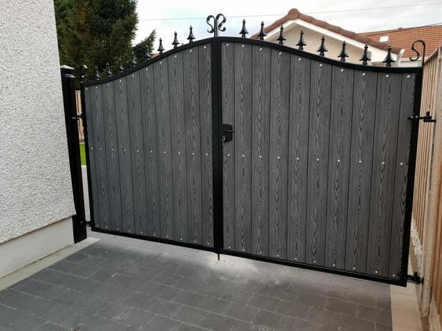 Decorative arched composite driveway gates