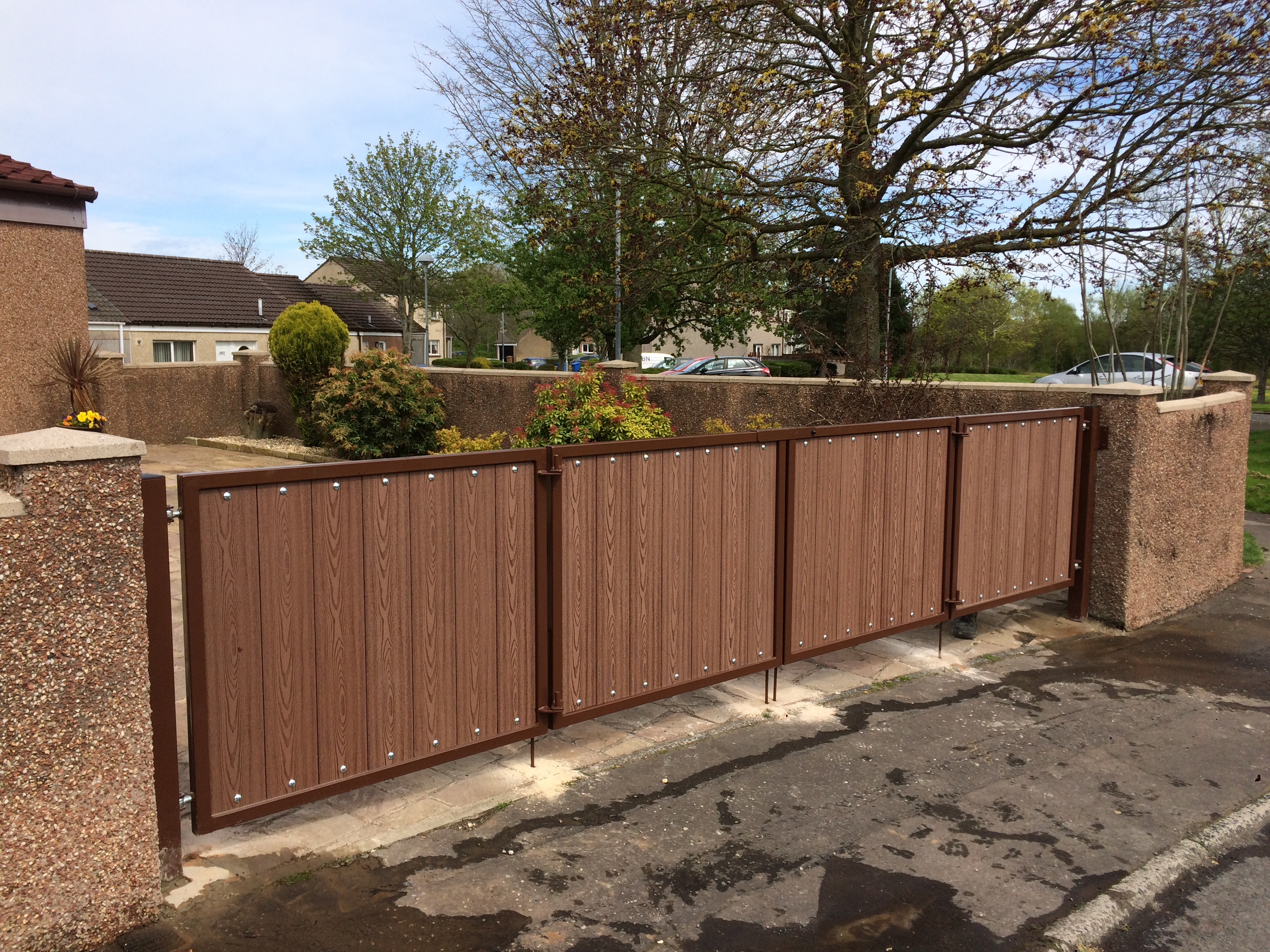 Composite wood gates with metal frame, supplied and fitted by Dain Art Iron.