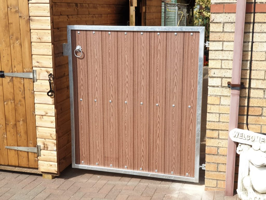 Galvanized frame composite wood side gate by Dain Art Iron