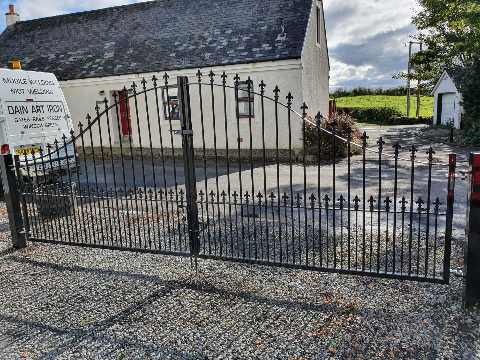 Bow arched driveway gates with railheads